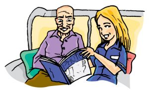 Careworker reading with service user