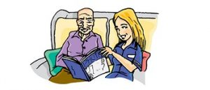 Care worker reading with service user